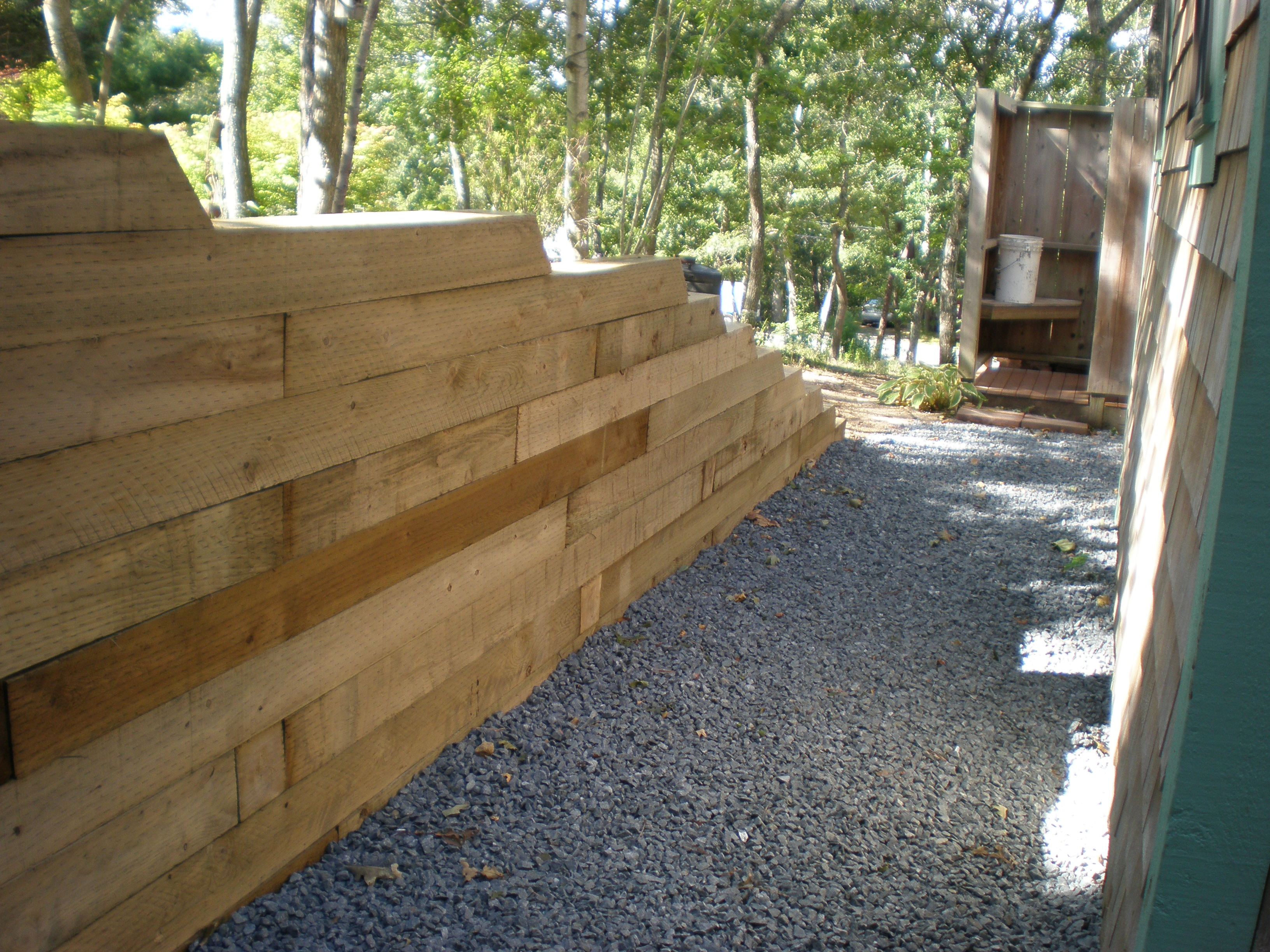 Landscape timber retaining wall Meyer Landscapes