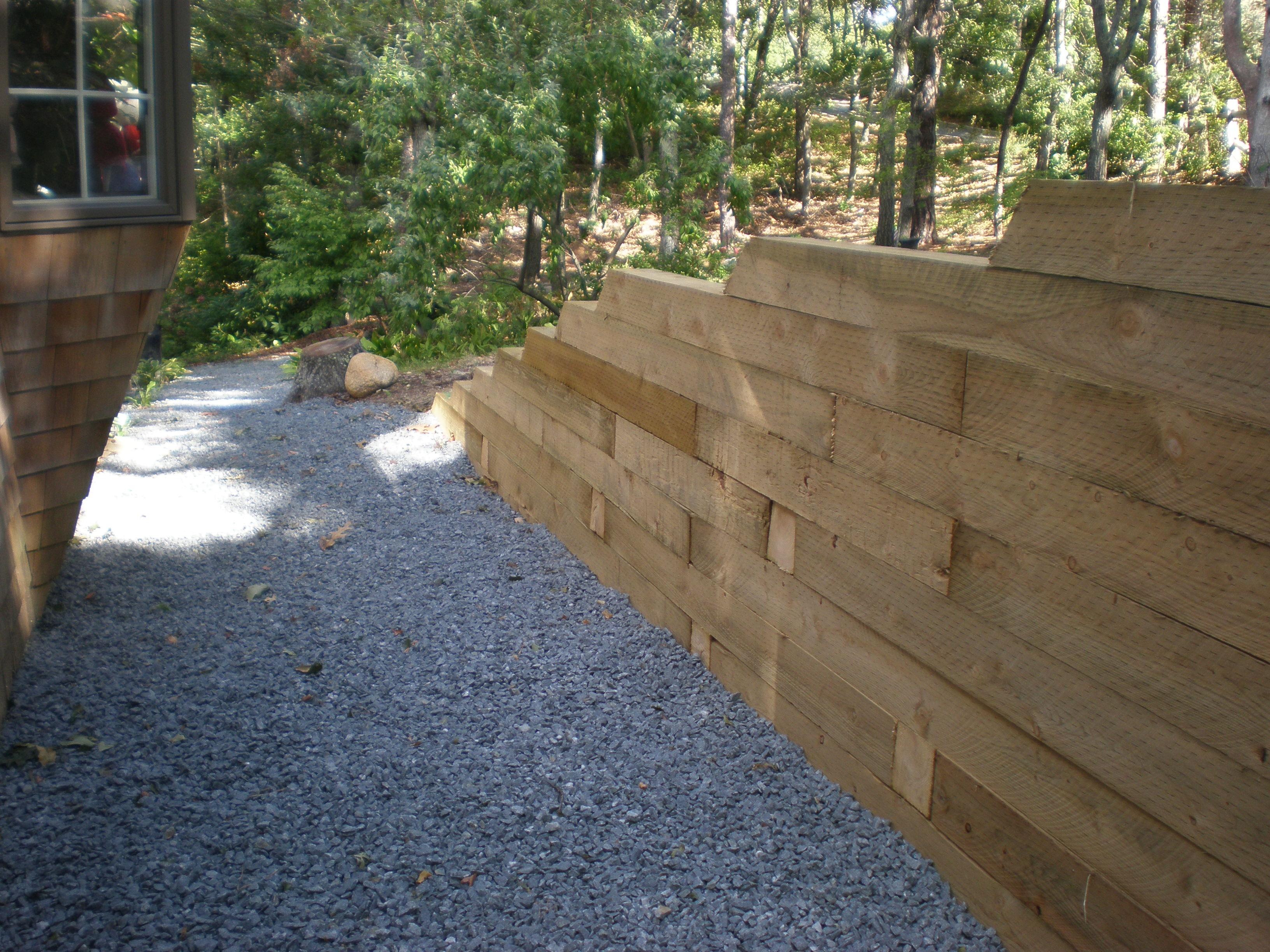 Landscape timber retaining wall Meyer Landscapes
